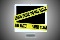 Internet crime. Computer screen wrapped around with a yellow band on the neutral background Royalty Free Stock Images