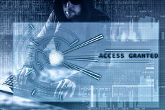 Internet crime concept, access granted. Hacker on dark digital background with head up interface around. Stock Photos
