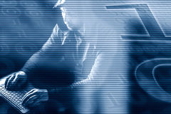 Internet crime concept.Hacker on blue digital background. Royalty Free Stock Photography
