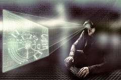 Internet crime concept.Hacker on dark digital background with head up interface around. Internet crime concept. Hacker on dark digital background Royalty Free Stock Images