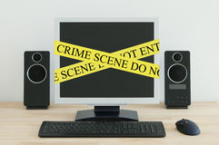 Internet Crime Scene. Computer on a desk with a Crime Scene label Stock Photography