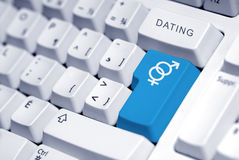 Internet dating. Symbol for a man and a woman on the computer Stock Photo