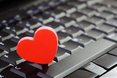 Internet dating. Love or online dating concept heart shape symbol on laptop keyboard Stock Images
