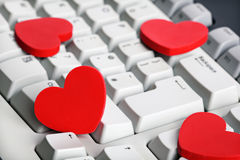 Internet dating. Love or online dating concept red heart shape symbol on white computer keyboard Royalty Free Stock Photos