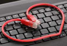 Internet dating. Computer keyboard and heart Stock Photo