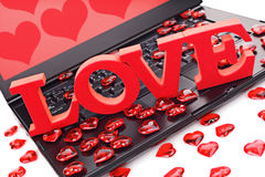 Internet dating. Love or online internet dating concept heart shape symbol on laptop keyboard Royalty Free Stock Images