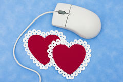 Internet Dating. Computer mouse with hearts � online dating services Royalty Free Stock Images