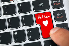 Internet dating. Computer keyboard key with find love and heart icon concept for online internet dating Stock Photos