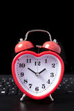 Internet dating. Heart clock on a laptop Stock Photo