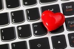 Internet dating. Love or online internet dating concept heart shape symbol on laptop keyboard Royalty Free Stock Image