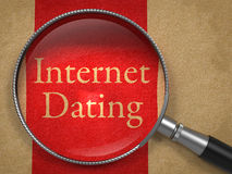 Internet Dating through Magnifying Glass. Internet Dating through Magnifying Glass on Old Paper with Red Vertical Line Stock Image