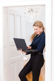 Internet Dating - Woman at home after work. Online Dating - Young businesswoman at home while using a laptop computer, for dating or reading emails Royalty Free Stock Photos