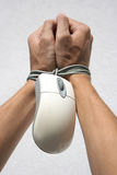 Internet dependency. Hands bound by mouse from computer Royalty Free Stock Photos
