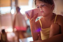 Internet dependency. Little girl using smart phone. Copy space. Close up stock image