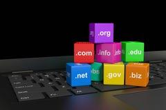 Internet Domain Names. Cubes on a Laptop Computer Keyboard 3D Illustration Royalty Free Stock Photos