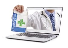 Internet drug store pharmacy concept doctor holding prescription royalty free stock images