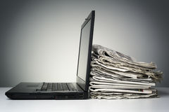 Internet and electronic online news. Laptop and newspaper concept for internet and electronic online news Stock Photography