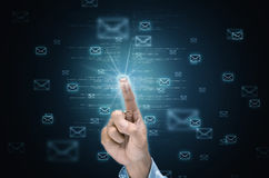Internet Email Concept. Internet Electronic mail concept with a hand selecting an email icon on air Royalty Free Stock Images