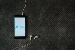 Internet explorer logo on smartphone screen. Los Angeles, USA, october 23, 2017: Internet explorer logo on smartphone screen and earphones plugged in on metal stock image
