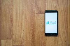 Internet Explorer on smartphone. Los Angeles, USA, july 13, 2017: Internet Explorer logo on smartphone screen on wooden background Royalty Free Stock Photography
