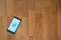 Internet explorer on smartphone screen. Los Angeles, USA, july 18, 2017: Internet explorer on smartphone screen placed on the laptop on wooden background Royalty Free Stock Images