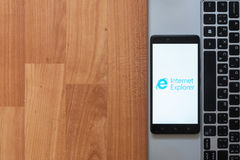 Internet explorer on smartphone screen. Los Angeles, USA, july 18, 2017: Internet explorer on smartphone screen placed on the laptop on wooden background Royalty Free Stock Image