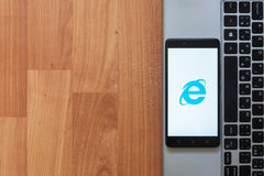 Internet explorer on smartphone screen. Los Angeles, USA, july 18, 2017: Internet explorer on smartphone screen placed on the laptop on wooden background Stock Images