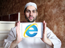 Internet explorer web browser logo. Logo of microsoft windows internet explorer web browser on samsung tablet holded by arab muslim man Stock Photography