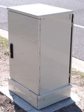 Internet fiber distribution cabinet roadside installed Stock Images