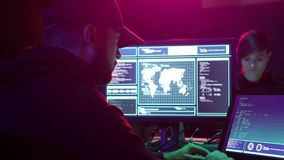 Internet fraud, darknet, data thief, cybercrime concept. Hacker attack on government server. Criminals coding virus. Programs in the basement stock footage