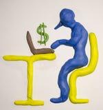 Internet gör inkomstplasticine Arkivfoto