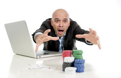 Internet gambling addict businessman on computer loosing lots of money betting on poker game Stock Photography