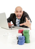 Internet gambling addict businessman on computer loosing lots of money betting on poker game Stock Image