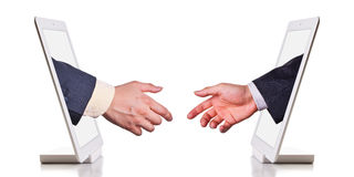 Internet handshake. The coming internet handshake through tablet pc - concept for internet deal, success for e-commerce or internet agreement Royalty Free Stock Photos