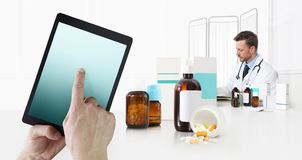Internet healthcare and medical on mobile devices consultation, hand touch screen on digital tablet, doctor at desk office with stock photography