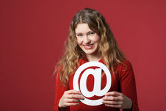 Internet icon. Young woman holding an Internet icon Royalty Free Stock Photo