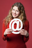 Internet icon. Young woman holding an Internet icon Stock Images