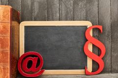 Internet law concept with blackboard and sign for email royalty free stock image