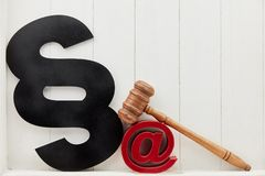 Internet Law Concept with Email Symbol and Paragraph. And judge gavel stock photos