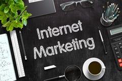 Internet Marketing on Black Chalkboard. 3D Rendering. Black Chalkboard with Handwritten Business Concept - Internet Marketing - on Black Office Desk and Other stock photo