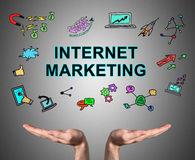 Internet marketing concept sustained by open hands Stock Image