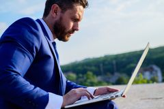 Internet marketing manager works blue sky background. Increase rates online sales tips. Businessman surfing internet or. Reply emails while sit with laptop royalty free stock photos