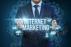 Internet marketing showing a businessman in hands . Royalty Free Stock Image
