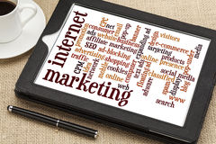 Internet marketing word cloud. On a digital tablet with a cup of coffee Stock Photos