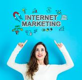 Internet Marketing with young woman looking upwards. Internet Marketing with young woman reaching and looking upwards Stock Photography