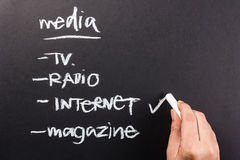 Internet media. Hand writing check mark on Internet from media channels Royalty Free Stock Photos
