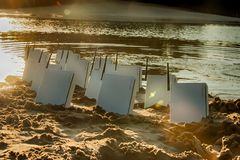Internet modems at the beach with setting sunbeams royalty free stock photo