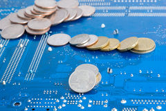 Internet money. Dollar and euro coins on technological background (computer motherboard royalty free stock images