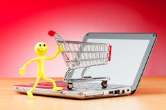 Internet online shopping concept. With computer and cart Stock Photo