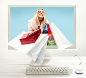Internet online shopping concept with computer and cart stock photos